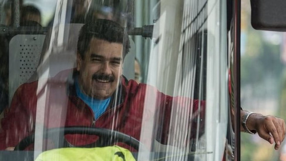 Venezuelan President Nicolas Maduro drives a bus while leaving the airport after arriving in Caracas on 17 January, 2015