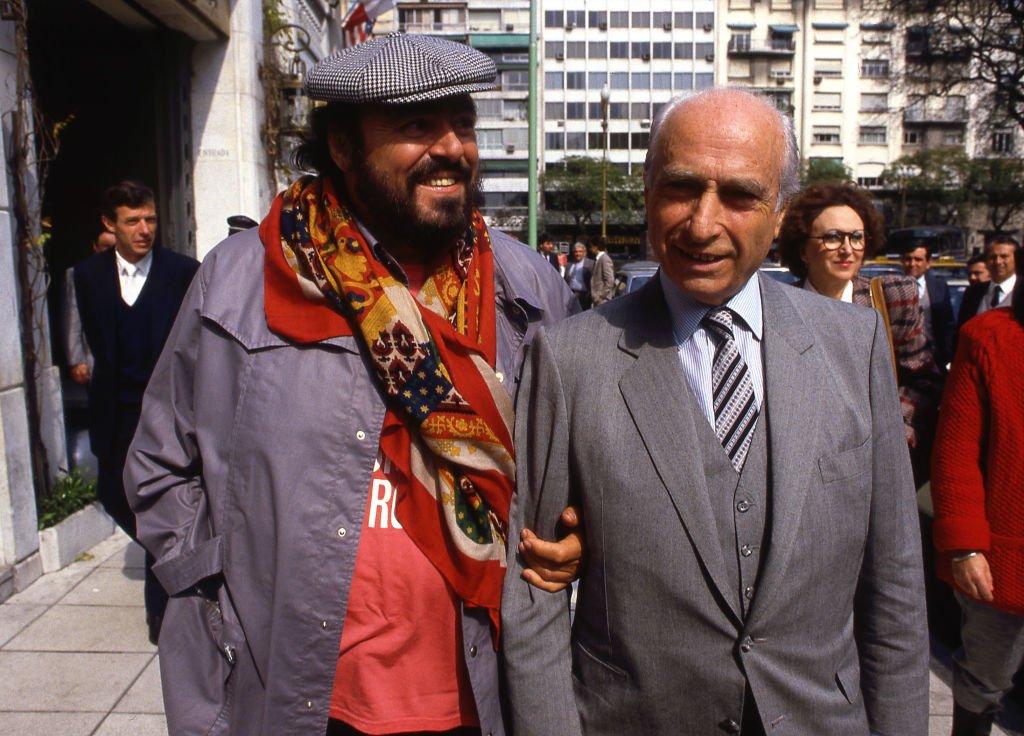 Luciano Pavarotti y Juan Manuel Fangio