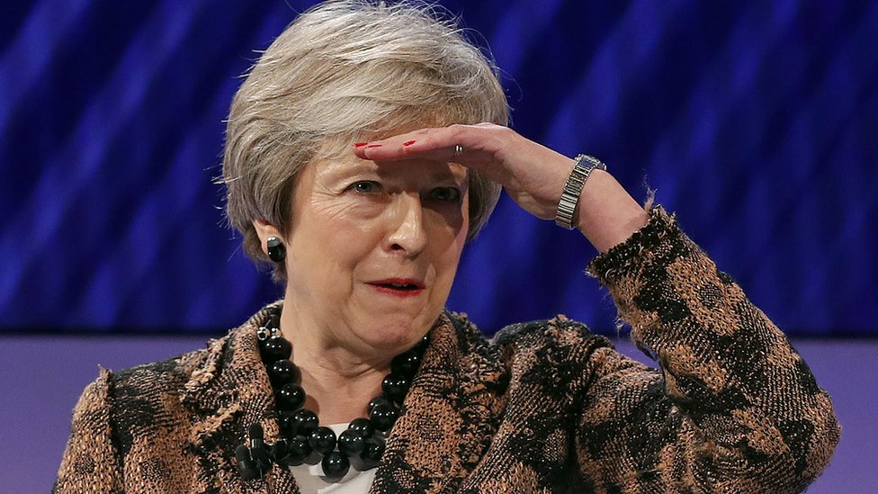 UK Prime Minister Theresa May gestures as she takes a question at the annual Confederation of British Industry (CBI) conference in central London, 19 November 2018
