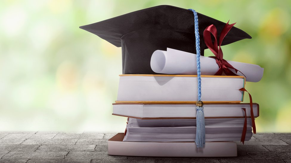 File photo of books and mortarboard