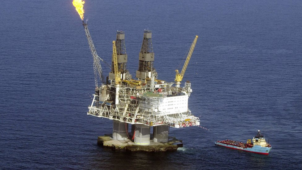 A flame burns off excess gas fumes on the top of the five-billion dollar drilling platform Hybernia off the coast of Newfoundland April 21, 2003 in the north Atlantic Ocean