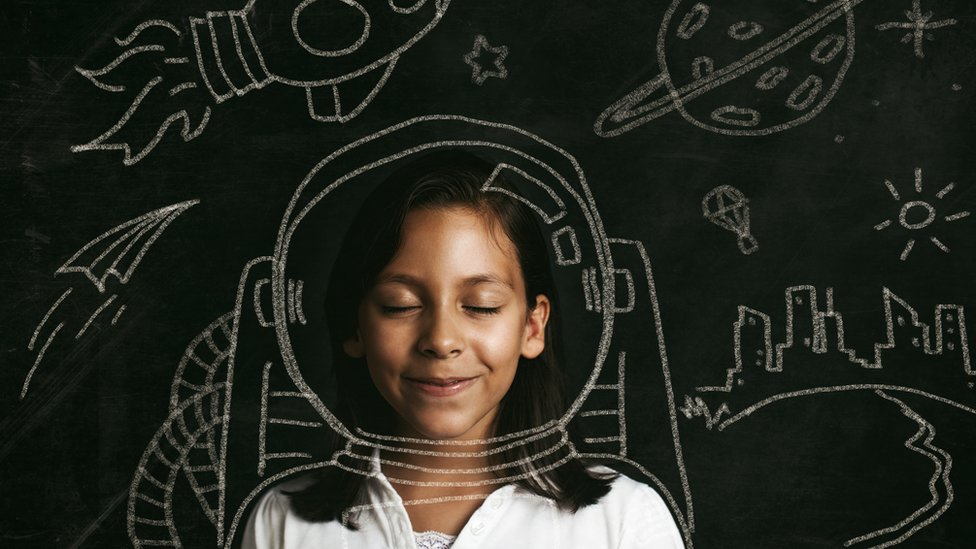 girl dreaming of being an astronaut