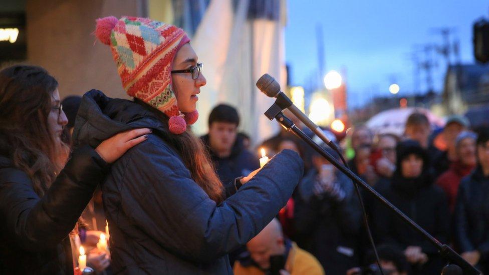 Sophia Levin speaks at a microphone