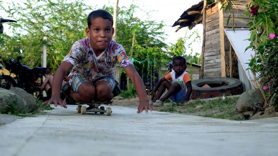 Boys playing on the street in Uraba