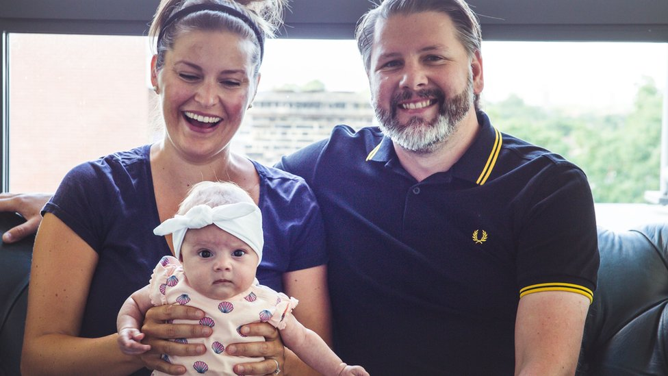Carly (left) and her husband (right) with their daughter, Ailish