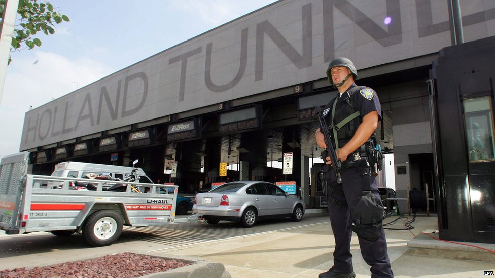 An armed policeman guarding the entrance to the Holland Tunnel