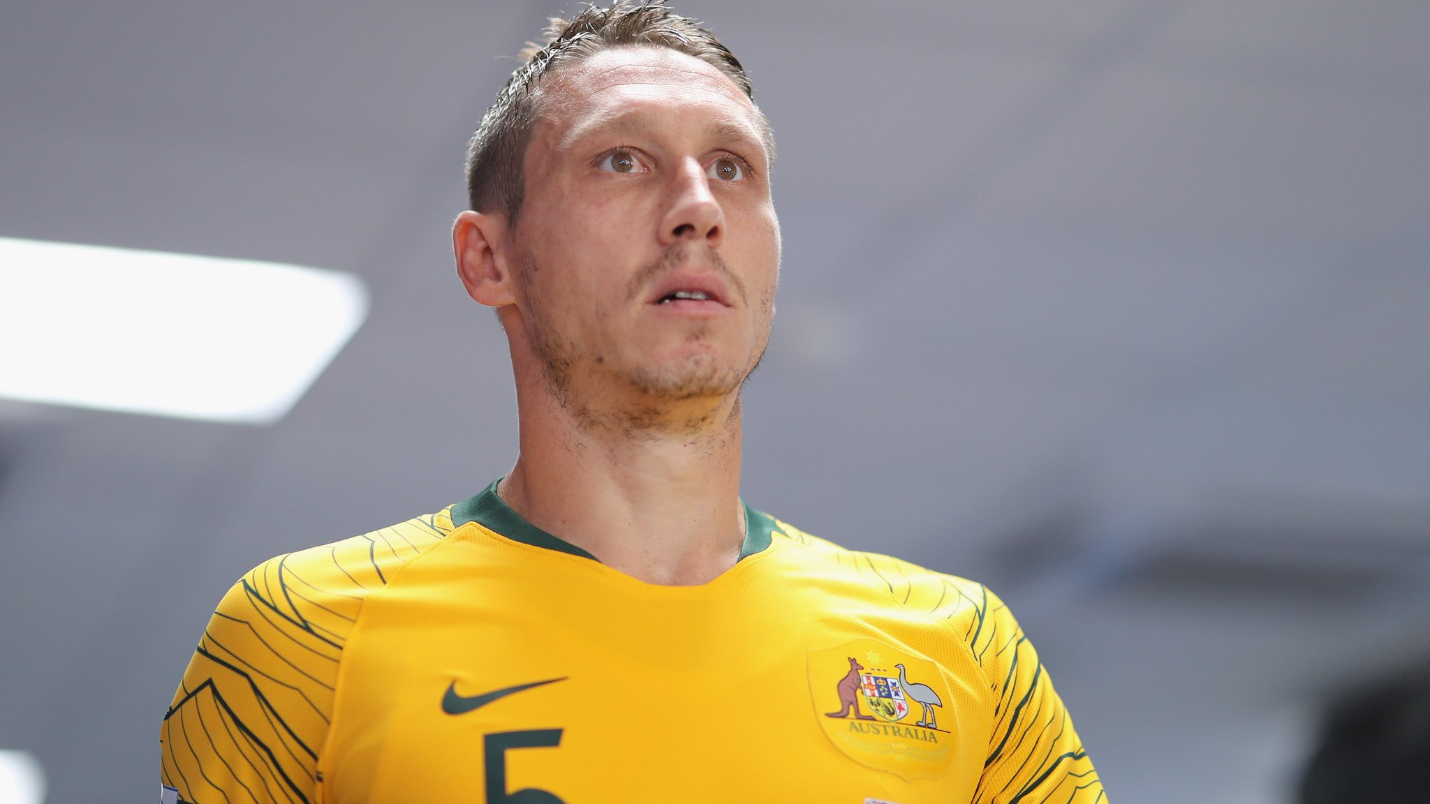 Mark Milligan: Hibernian sign Australia midfielder
