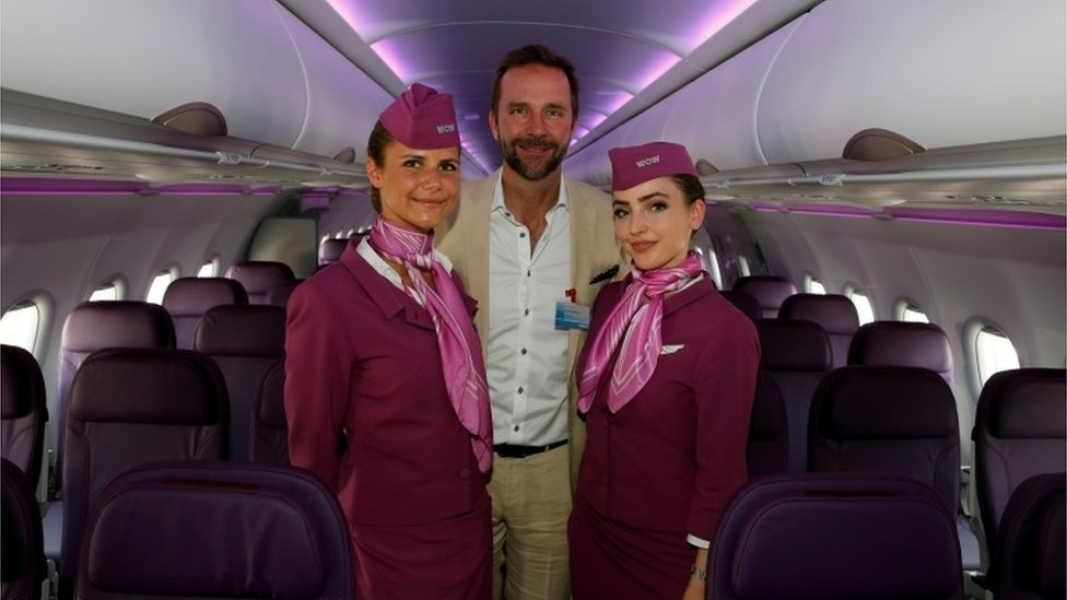 Founder of Wow Air and chief executive Skuli Mogensen with cabin crew