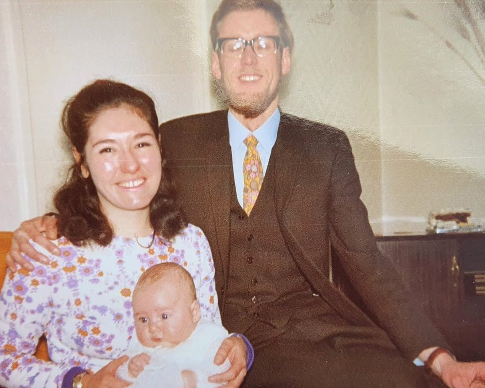Kathleen and Bernie Webb with me in a Christening gown