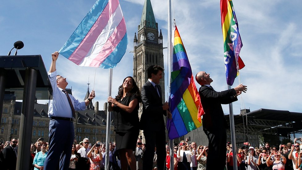 Canada's Public Safety Minister Goodale, Justice Minister Wilson-Raybould, PM Trudeau and Liberal MP Boissonnault raise pride flags on Parliament Hill in Ottawa