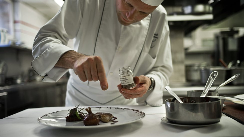 French chef Patrick Bertron adds some Poivre de Cassis, a pepper from blackcurrant bays, on May 27, 2010