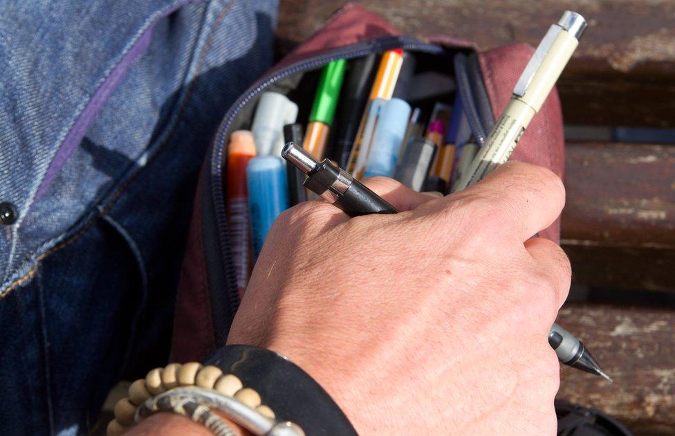 Stephen O'Grady reaching into his pencil case