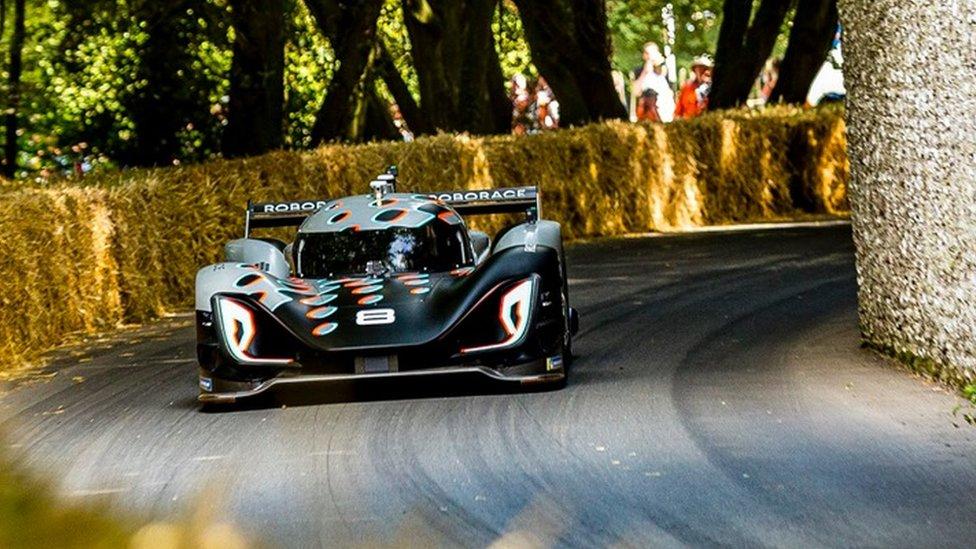 Roborace car racing up the hill climb at Goodwood