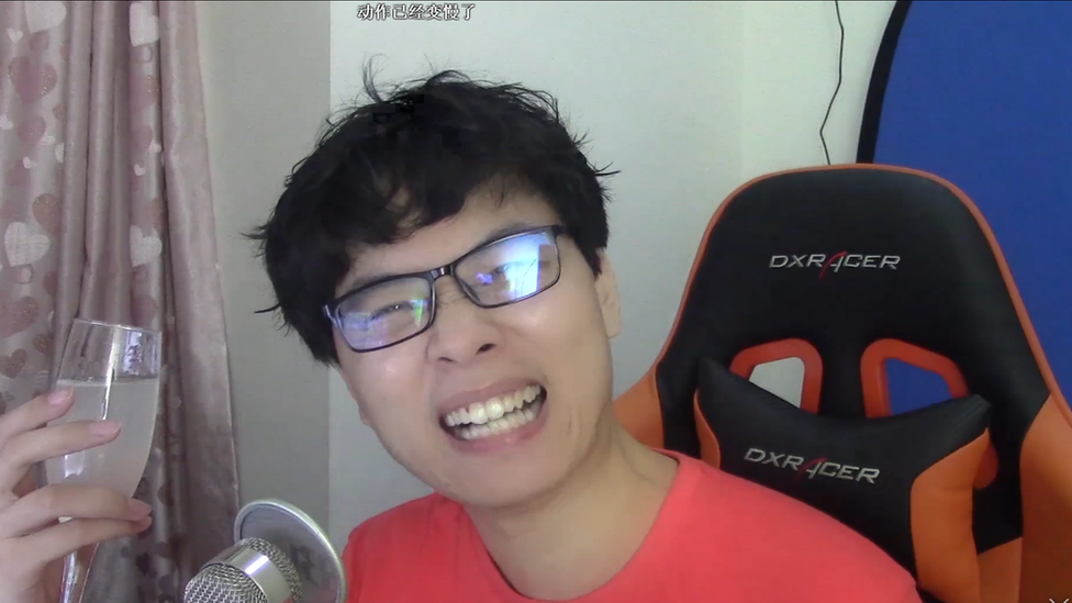 A vlogger with the username zheteng5hao in a video about Four Loko