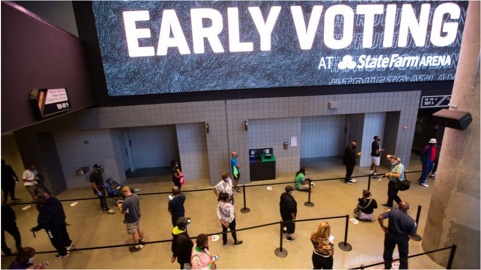 Voters in Atlanta queue to vote in an NBA arena