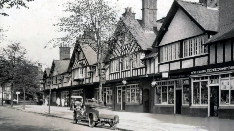 Shops at Bournville village green in 1925