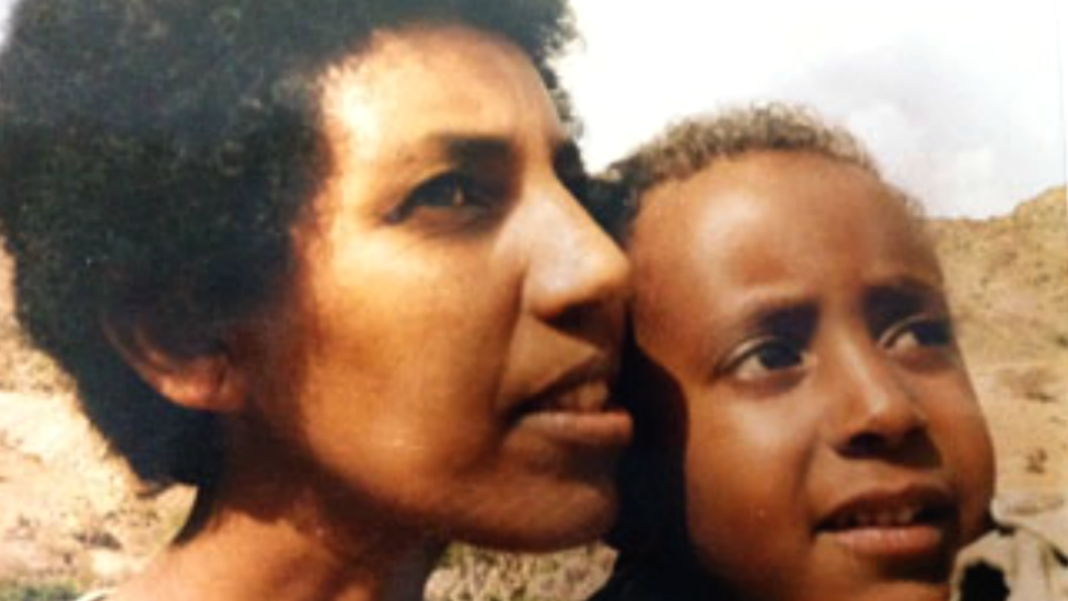 Aster Fissehatsion and her son Ibrahim Sherifo when he was a young boy in 1990