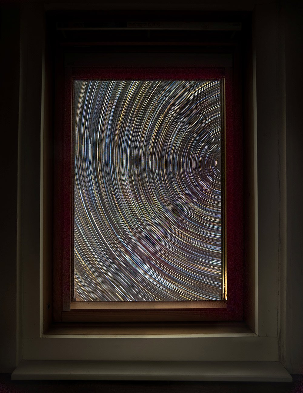 Star trail taken from inside a house in Shropshire