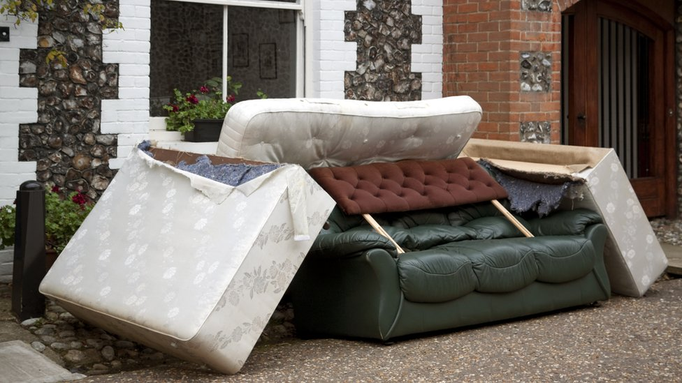 Furniture piled up outside a house
