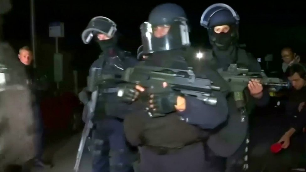 Still image taken from video shows police arriving at the scene near where a French police commander was stabbed to death in front of his home in the Paris suburb of Magnanville, France, early on 14 June 2016