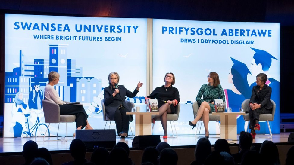 Hillary Clinton leads a panel at Swansea University