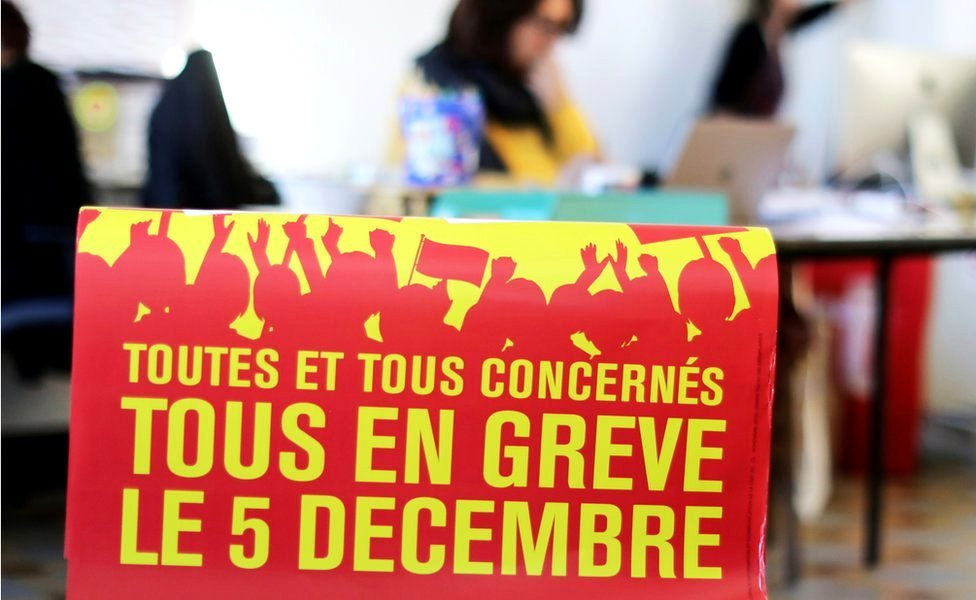 """A poster reads: """"All on strike on 5 December"""" - at the Bourse du Travail during preparations for the national strike against the French government's pension reform plans, in Nice"""