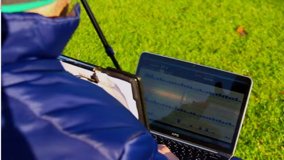 Coach with laptop showing data