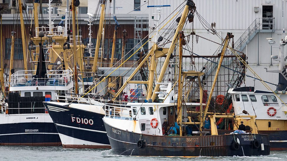 The Harvester beam trawler heads out to sea after being moored in Brixham harbour
