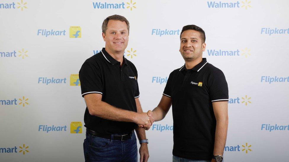 Flipkart co-founder and chief executive Binny Bansal (right) with Walmart chief Doug McMillon
