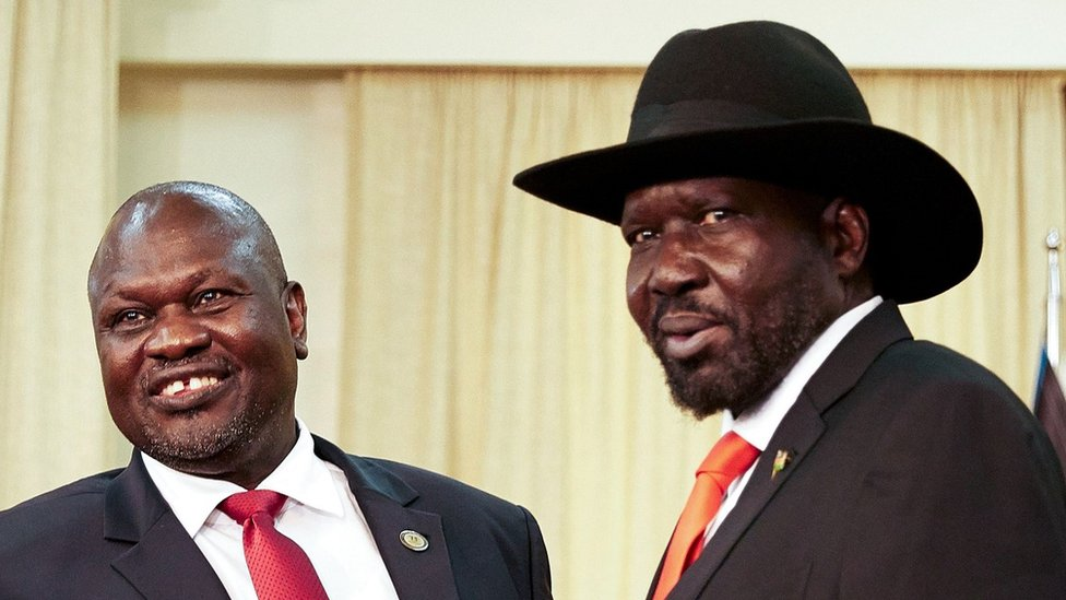 South Sudan's ex-vice president and former rebel leader Riek Machar (L) meets with South Sudan's President Salva Kiir at the presidential office in Juba, on October 19, 2019.