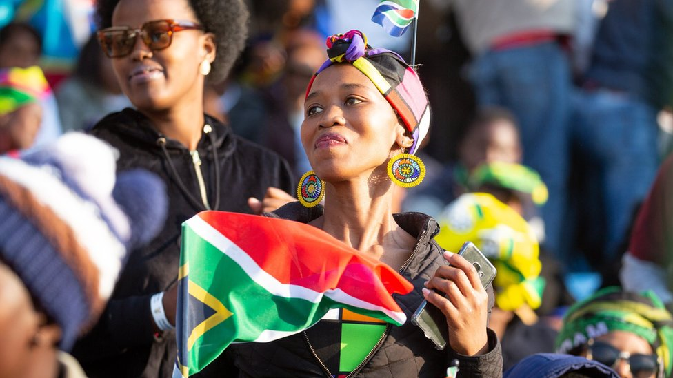 Women waving the South African flag
