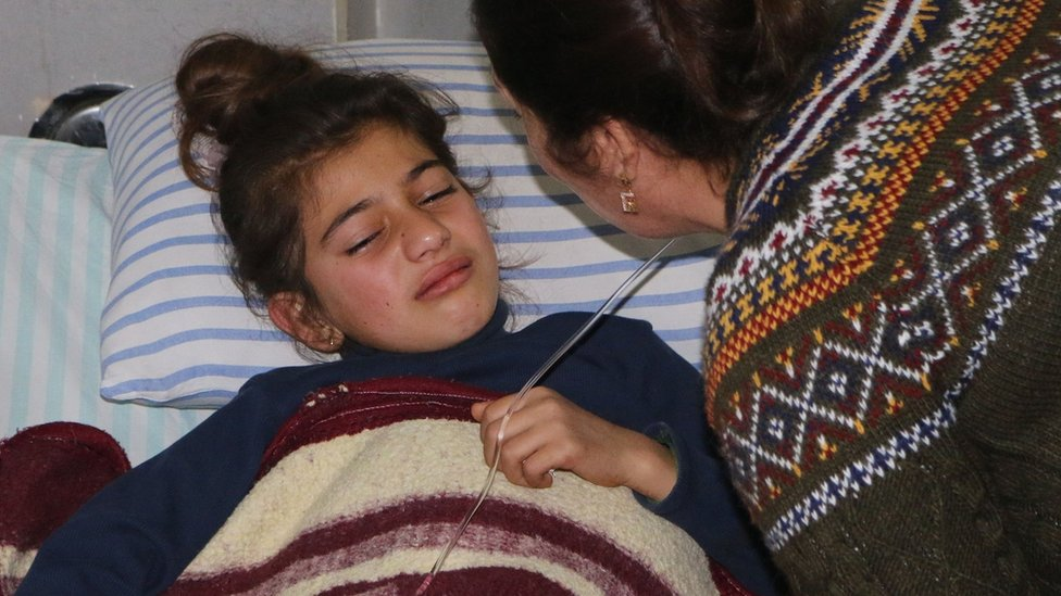 A mother comforts her wounded daughter at a hospital in the Kurdish enclave of Afrin, Syria (20 February 2018)