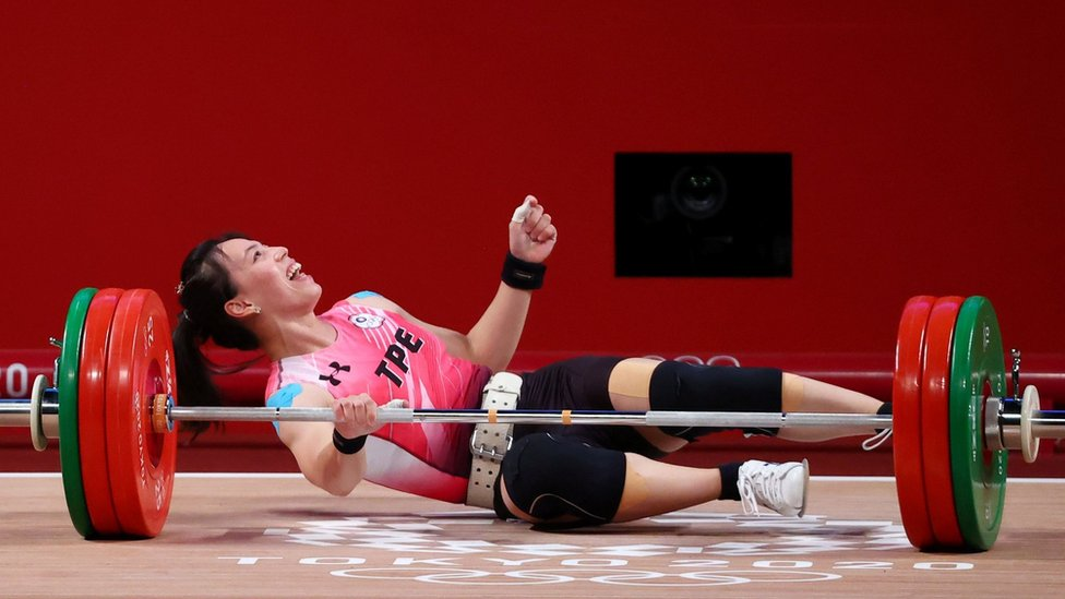 """Tokyo 2020 Olympics - Weightlifting - Women""""s 59kg - Group A - Tokyo International Forum, Tokyo, Japan - July 27, 2021. Kuo Hsing-Chun of Taiwan reacts after failing a lift."""
