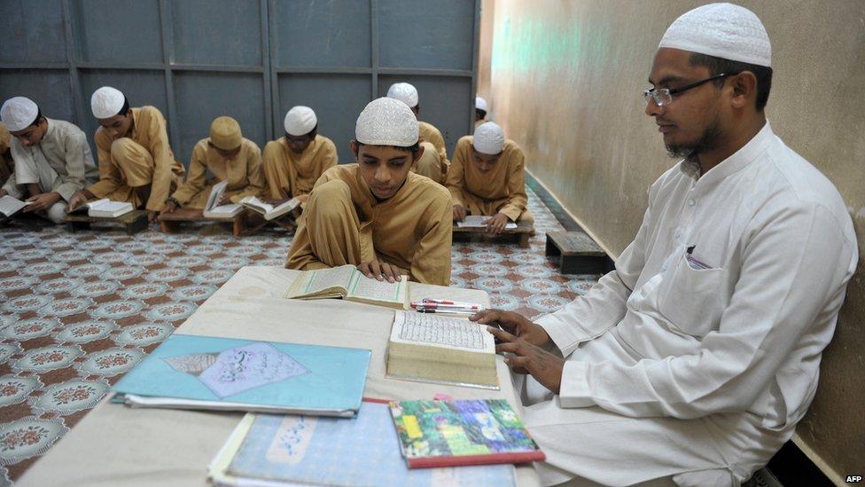 Indian Muslim students recite from the Koran in a classroom at the Madrasa Islamia Darul-Uloom Ashrafia in Hyderabad 24 June 2015