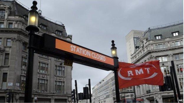 An RMT flag flies at the closed Tube station entrance at Oxford Circus