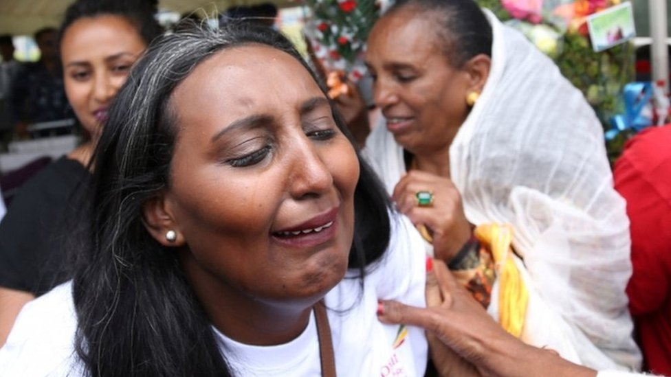 Senait Zaro, reacts as she meets her family for the first time in fifteen years, at Asmara International Airport, who arrived aboard the Ethiopian Airlines ET314 flight in Asmara, Eritrea July 18, 2018