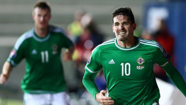 Kyle Lafferty celebrates scoring the equaliser for Northern Ireland against Hungary