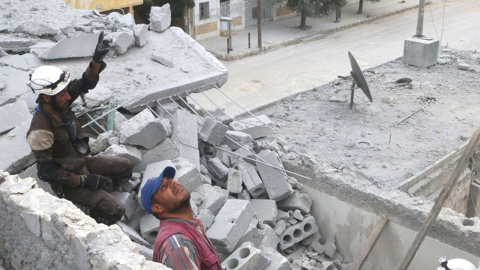 Rescue teams in the rubble of a building in Aleppo. 3 May 2016