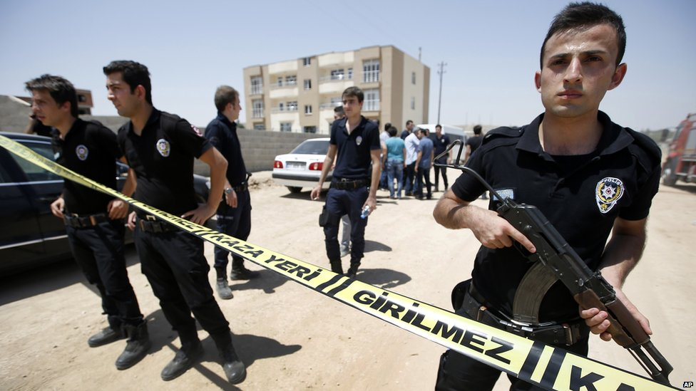 Police outside the building where the bodies were found on 22 July, 2015