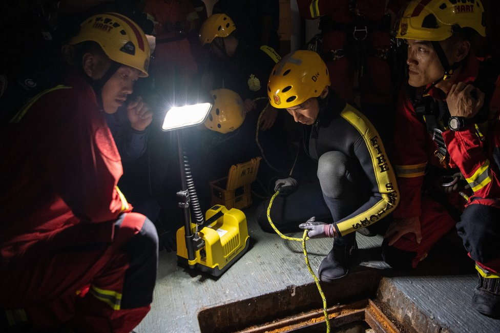 Fire service department personnel inspect a sewer after receiving a report that anti-government protesters had attempted to escape Hong Kong Polytechnic University through the sewage system on November 19, 2019 in Hong Kong, China