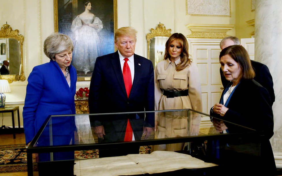Mr and Mrs Trump are shown a copy of the American Declaration of Independence