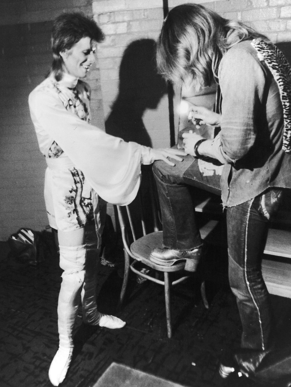 Make-up artist Pierre La Roche prepares English singer David Bowie for a performance as Aladdin Sane, 1973. Bowie is wearing a costume by Japanese designer Kansai Yamamoto