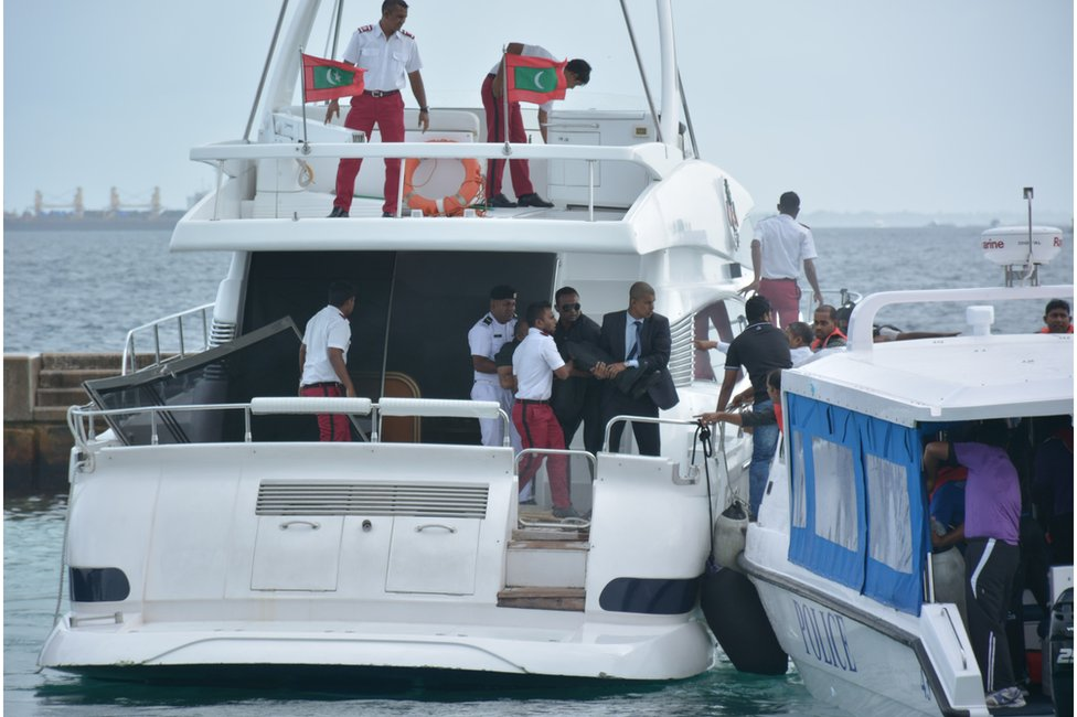 Unidentified injured people are evacuated after a blast on the Maldives President Yameen Abdul Gayoom speedboat in Male, Maldives Monday, 28 Sept 2015