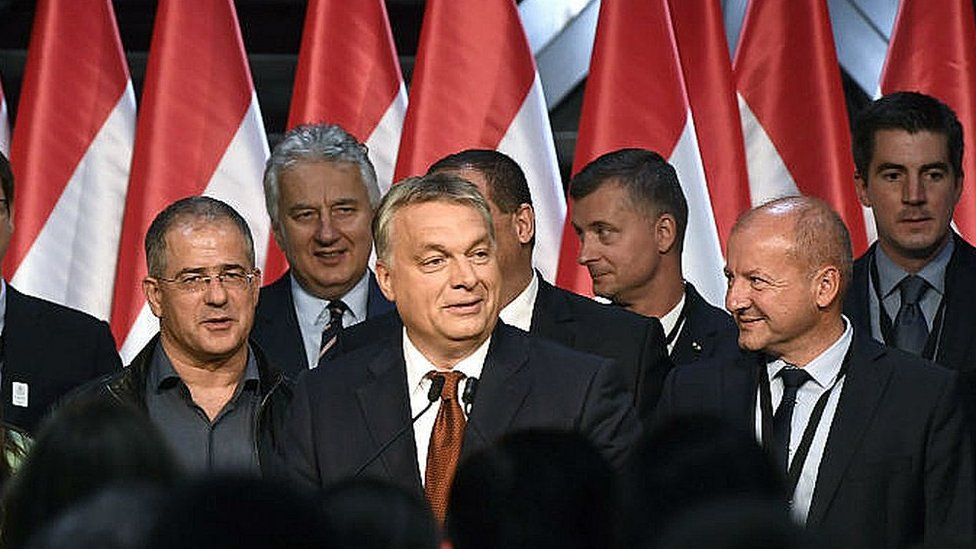 Hungarian Prime Minister Viktor Orban, centre, delivers speech after referendum in Budapest. October 2, 2016