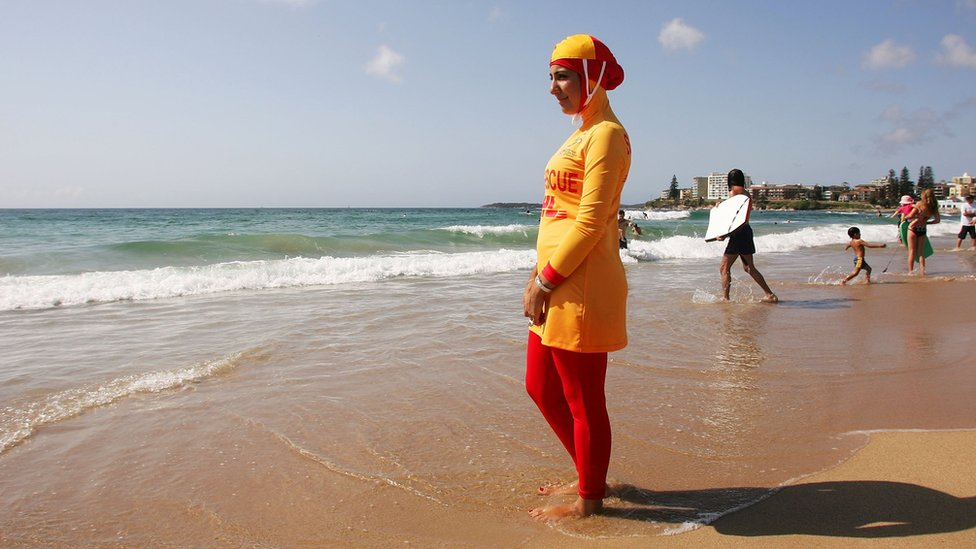 Muslim life guard wearing a burkini on a beach in Sydney, Australia