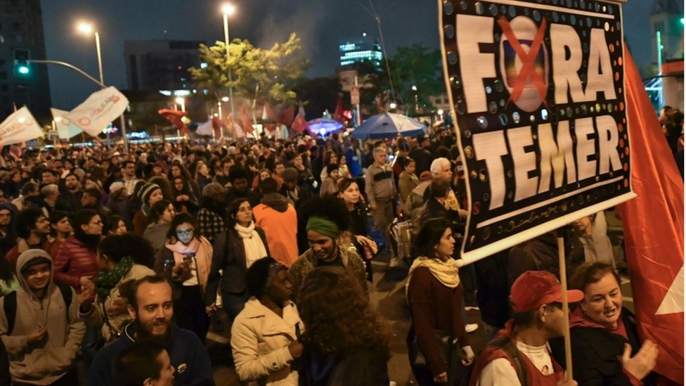"""Temer out"" reads a banner at an opposition march in Sao Paulo"