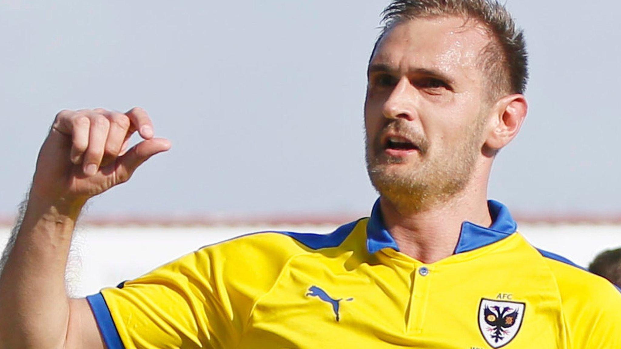 James Hanson: Grimsby bring in striker from AFC Wimbledon