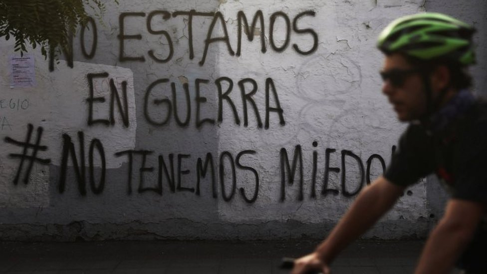 """Graffiti on a wall in Santiago proclaims: """"We're not at war #we're not afraid"""""""