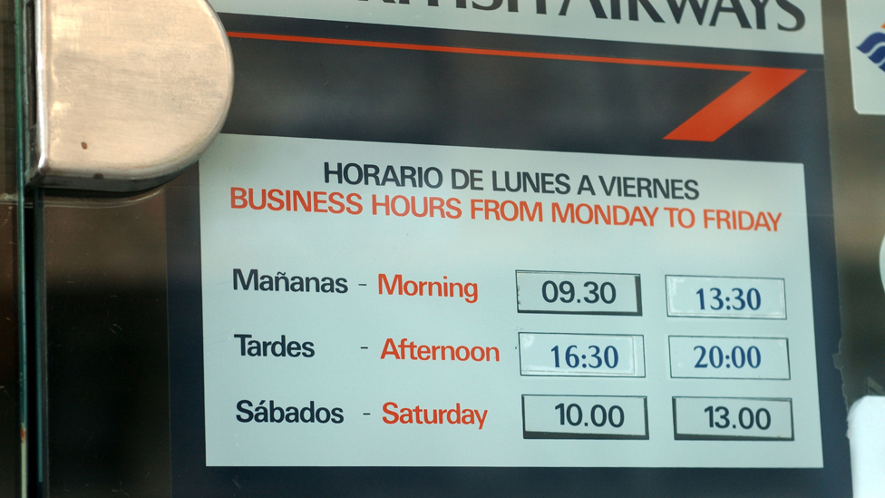 Palma de Mallorca, Spain. Opening hours at a travel agent allow for an afternoon siesta.