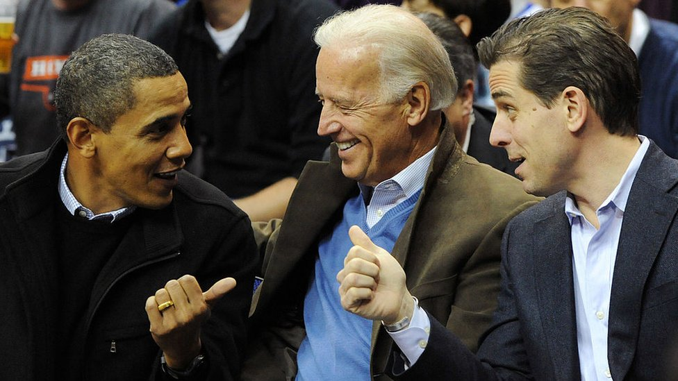 Barack Obama sits with Joe Biden and his son Hunter at a basketball game in 2010